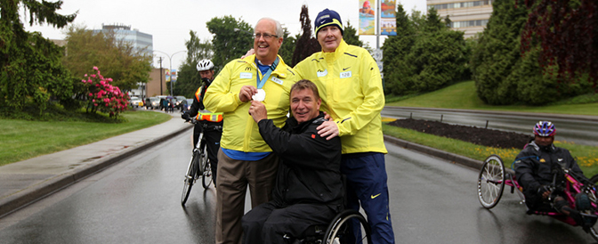 With-Rick-Hansen-and-John-Furlong-during-Rick-Hansen's-Anniversary-Relay